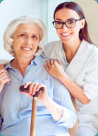 caregiver and elderly woman both smiling